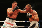 Brian Minto (left) beat Shane Cameron after seven rounds last night. Photo / Getty Images