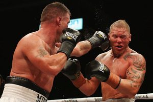 Brian Minto (left) of the USA fights Shane Cameron during the Fight for Life. Photo / Getty Images