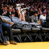 Los Angeles Lakers' Steve Blake falls over courtside chairs as he tries to save a ball from going out. Photo / AP