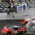 Kyle Larson (32) goes airborne and into the catch fence in a multi-car crash  during the final lap of the Nascar  Nationwide Series  at Daytona Beach. Photo / AP