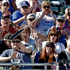 Fans try to get out of the way after Chicago Cubs' Christian Villanueva loses his bat during a training game against the Colorado Rockies. Photo / AP