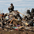 A man sits on his flattened home after a tornado in Oklahoma. Photo / AP