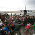 Survivors swarm the Philippines' Tacloban airport for a flight. Photo / AP