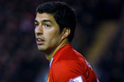 Luis Suarez says he is delighted with his new deal with Liverpool. Photo / AP