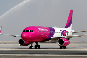The woman went into labour just as the Wizz Air jet came in for landing, giving birth just after it touched down. Photo / AP