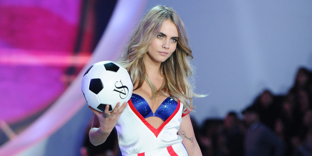 Model Cara Delevingne walks the runway during the 2013 Victoria's Secret Fashion Show. Photo / AP