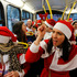 Revellers dressed up in Santa outfits travel on a bus in London during SantaCon in London, England. Photo / AP