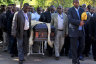 Nelson Mandela's grandson Mandla Mandela leads local chiefs as they escort the lion skin draped casket of the former South African President as it arrives at the Mandela residence. Photo / AP