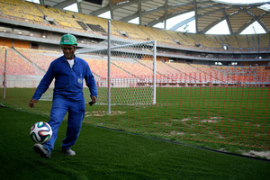 Construction worker Cicero Nogueira de Almeida plays with a ball at the stadium in Manaus, Brazil. Another worker, Marcleudo Ferreira, fell some 115 feet to his death. Photo / AP
