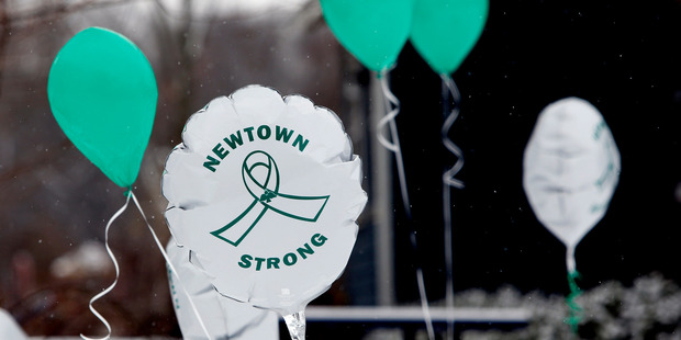 Balloons fly on the first anniversary of the Sandy Hook massacre, in Newtown, Connecticut. Photo / AP