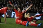 Luis Suarez celebrates after scoring against Tottenham yesterday. Photo / AP