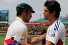 England's Alastair Cook, right, shakes hands with Australia's Mitchell Johnson, left, after Australia defeated England. Photo / Getty Images