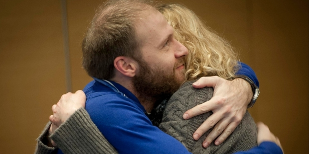 Photographer Denis Sinyakov of Russia and Greenpeace activist Sini Saarela of Finland embrace each other after hearing about the amnesty bill. Photo / AP