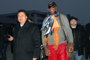 Dennis Rodman walks with Vice Minister of North Korea's Sports Ministry, Son Kwang Ho. Photo / AP