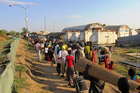 Civilians fleeing violence seek refuge at the UNMISS compound in Bor. Photo / AP