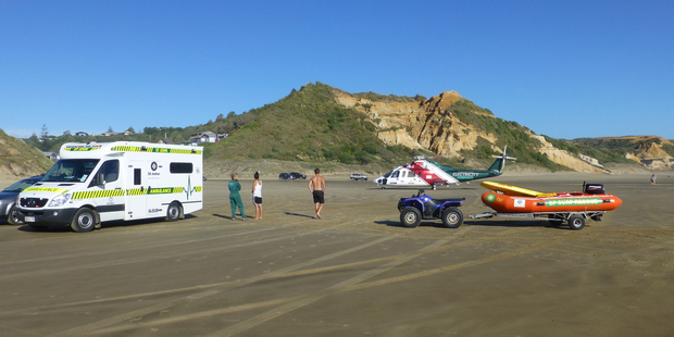 Rescuers at Baylys Beach where a 23-year-old woman who stuck trouble in the surf had to be evacuated to hospital. Photo/Northland Emergency Services Trust.