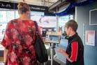 Ann Maree Jago passes through a ferry ticketing booth. Photo / Kirsty Wynn