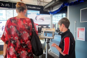 Ann Maree Jago passes through a ferry ticketing booth. Photo / Kirsty Wynn