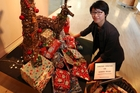 Whangarei Art Museum assistant director Yu-San Kang places gifts donated to the Whangarei Women's Refuges. Photo/John Stone