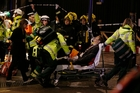 A man is wheeled away after the Apollo Theatre ceiling collapse. Photo / AP