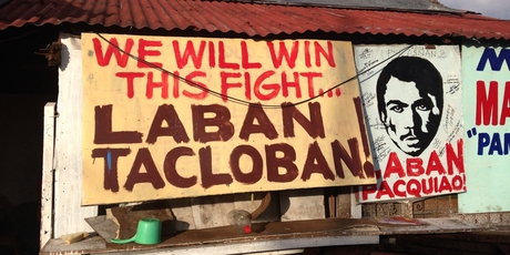 A sign on the streets of Tacloban is evidence of the people's grit and fight.