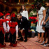 The US first family, from left, President Barack Obama, Malia Obama, first lady Michelle Obama, and Sasha Obama greet children dressed like elves in Washington. Photo / AP