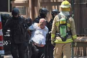 Ganiji is taken away. Photo / AP