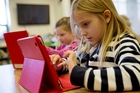 Children around the world have embraced the iPad. Photo / AP