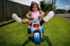 Latai Liuanga, 2, with the bike given to her by the Cystic Fibrosis Association. Photo / Sarah Ivey