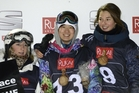 Rebecca Sinclair, left, and halfpipe winner Li Shuang with Clemence Grimal, who was third. Photo / AP