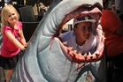 Freddie the Shark devours another young visitor to Paihia. Photo / Peter de Graaf