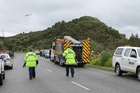 The NZCC Rescue Helicopter hovers near the scene of a double fatality on the Taylorville Road, east of Greymouth. The vehicle crashed into a small gully, at right. Photo / Greymouth Star