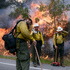 Firefighters take a break while lighting a backfire along Highway 1 between Pfeiffer Ridge Road and the Big Sur Station in Big Sur, California. Photo / AP