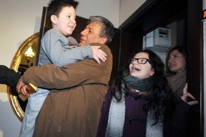 Turkish journalist Mustafa Balbay (C) poses with members of his family after being released from 5 years in prison. Photo / AFP
