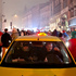 A taxi is stuck as demonstrators march on the road during a protest in Bucharest, Romania. Photo / AP