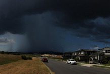 A thunderstorm danced around Flat Bush in Auckland this afternoon. Photo / Tim Hazell