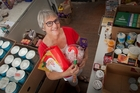 CHRISTMAS SPIRIT: Gillian Tustin has spent three weeks working full time packing food parcels. PHOTO/ANDREW WARNER