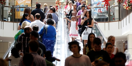 Christmas shoppers crowd the escalators at Westfield St Lukes yesterday. Photo / Chris Gorman