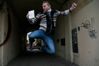 Dutch Greenpeace activist Mannes Ubels celebrates after getting his exit visa from Russia. Photo / AP