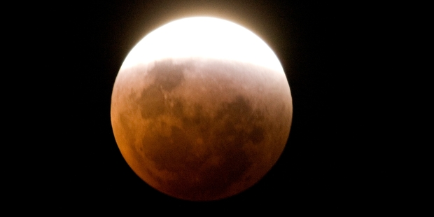 The lunar eclipse will be quite eerie with the moon looking like a dim red disc, says an expert. Photo / Mark Mitchell