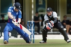 Luke Ronchi (right), in action against England's Eoin Morgan, has first dibs on wicketkeeping. Photo / APN