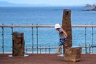 A child plays on Chris Bailey's 'Te Wai Puna o Rona' stone sculpture. Photo / Bob Scott