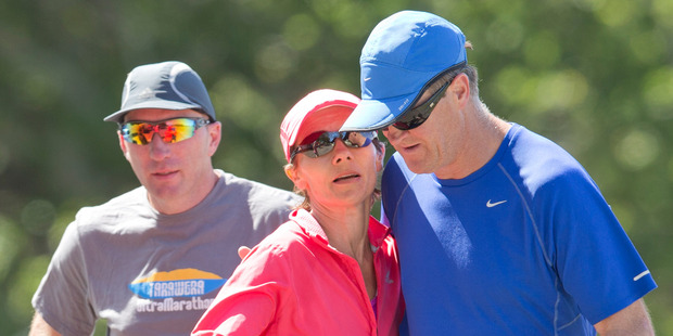 Kim Allan was helped through the last few kilometres with the support of friends and family. Photo / Greg Bowker