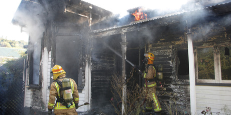 Firefighters believe the occupants were at work when the fire started. Photo/Bevan Conley.