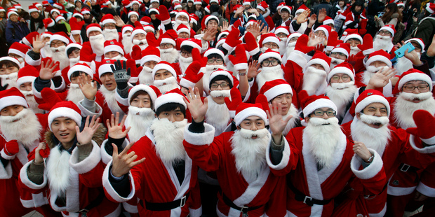 Some 1,000 volunteers clad in Santa Claus costumes gather to deliver gifts for the poor in downtown Seoul, South Korea.