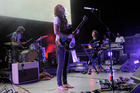 Kevin Parker, center, and his band Tame Impala. Photo / AP