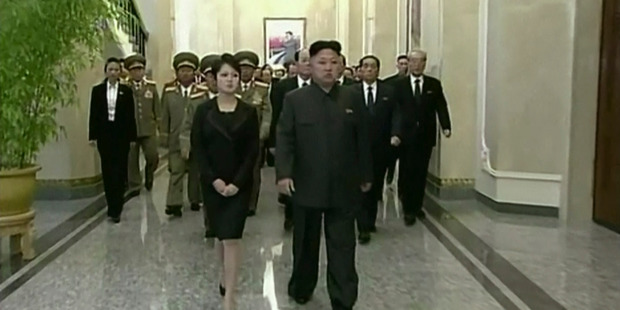 North Korean leader Kim Jong Un, center right, his wife, Ri Sol Ju, center left, and high ranking officials. Photo / AP
