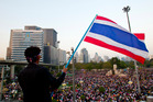 Thai anti-government protesters wave their national flag in Bangkok, Thailand. Photo / AP