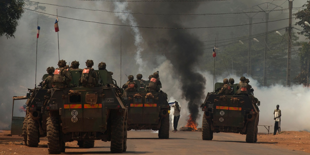 Seleka supporters protest as French troops roll into the CAR capital Bangui. Photo / AP