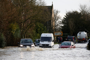 About 1000 homes have been flooded this week in Great Britain. Photo / AP